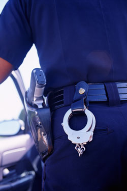 Police Officer with handcuffs responding to burglary and theft call.